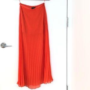 Neon orange pleated skirt